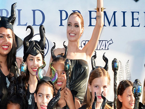 Angelina Jolie And Brad Pitt Walk The 'Maleficent' Red Carpet